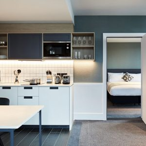 Hyatt-House-Manchester-Suite-Kitchenette-and-Bedroom